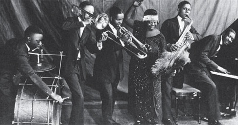 A line-up of black musicians in the 1920s, including a fabulously dressed Ma Rainey