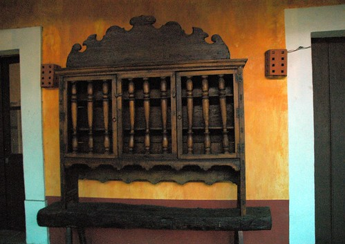 Handmade wood cupboard, orange, maroon, turquoise painted walls, historical building, La Fonda de San Miguel Arcangel, (The Fountain of Michael the Archangel), a fine restaurant, Guadalajara, Jalisco, Mexico by Wonderlane