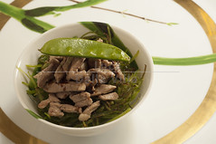 Julienne of crunchy snow peas and liquorice veal s…