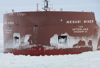 The motor vessel Mesabi Miner, a 990-foot laker, suffered a puncture in its bow about 4 feet above the waterline during a collision with the Coast Guard Cutter Hollyhock, a 225-foot sea-going buoy tender homeported in Port Huron, Mich., in northern Lake Michigan, Jan. 5, 2014. Both the Hollyhock and the Mesabi Miner were damaged in the collision but were able to continue underway. U.S. Coast Guard photo