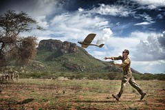 A soldier launches a Desert Hawk, Unmanned Aerial Vehicle (UAV).