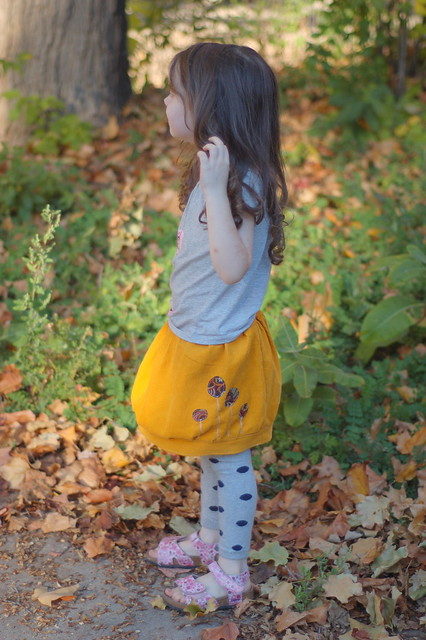 gathering leaves in her new Urban Sprout corduroy tulip skirt