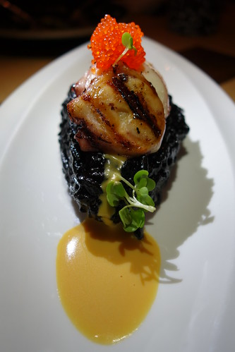 Morsels: Grilled House Poached Octopus, Squid Ink Risotto, Salted Egg Sauce, Tobiko & Wasabi Sprouts.