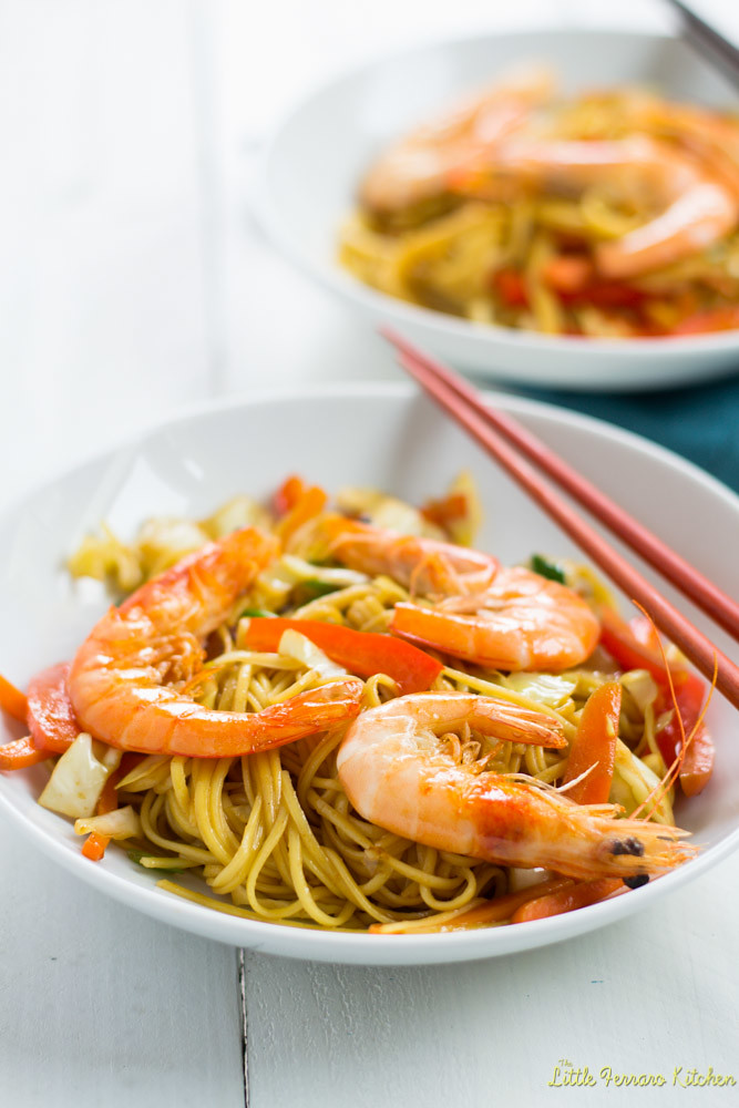 Learn how to make shrimp chow mein recipe with fresh vegetables, head on shrimp and delicious soy based sauce, easily cooked together in a wok.