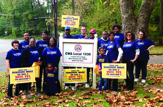 NJ CWA members and allies rally voters to increase the minimum wage.