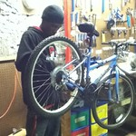 Terrell working on his bike.