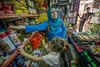 """Amina said that she never thought she would find relief in a former prison. """"Here in Akre I am able to buy more food, because I can shop in stores where I can find products for lower prices,"""" she said.   Photo: EU/ECHO/Peter Biro."""