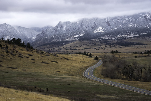bouldercounty colorado landscape rockymountains clouds cycling cyclist mountains plains snow snowclouds springsnow