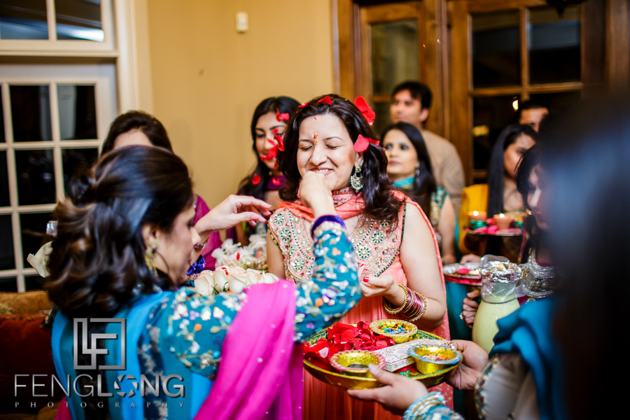 Throwing flower petals for Mehndi entrance on bride's side