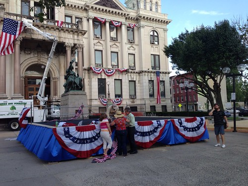 Erecting the stage, with bunting, for Jersey City mayoral inauguration
