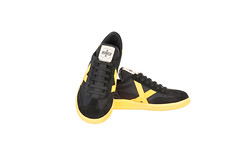 textile(0.0), leather(0.0), suede(0.0), outdoor shoe(1.0), sneakers(1.0), footwear(1.0), yellow(1.0), shoe(1.0), skate shoe(1.0), athletic shoe(1.0), black(1.0),