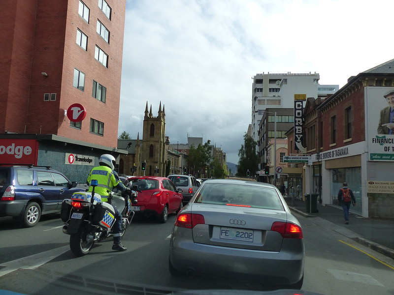 1 of 12: the excitment of a police bike in traffic