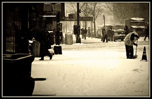 shoveling snow from sidewalk