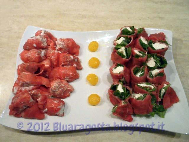 Vassoio di carpacci e uova di quaglia marinate alla cracco