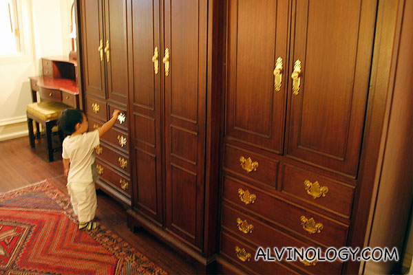 Asher inspecting all the large wardrobes in our suite