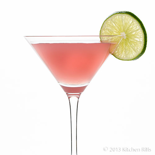 Bacardi Cocktail in cocktail glass with lime garnish, white background