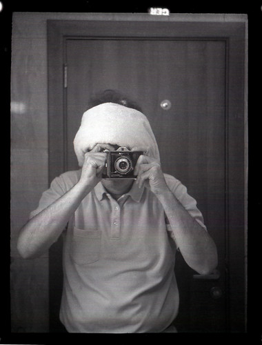 reflected self-portrait with Ensign Selfix 16-20 camera and hastily improvised headgear by pho-Tony