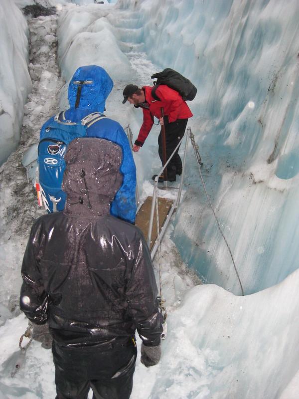Crossing an ice chasm on Franz Josef Glacier - New Zealand