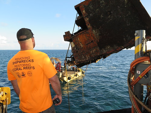 Removing part of the Hui Feng No. 1 shipwreck at Palmyra Atoll NWR. Photo Credit: Amanda Pollock/USFWS.