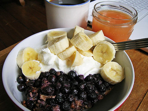blueberry walnut baked oatmeal, greek yogurt, bananas, coffee, and grapefruit juice