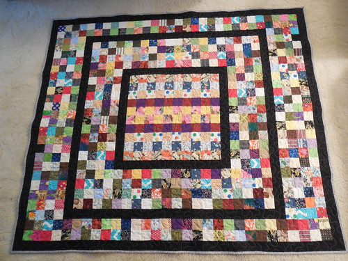 """2.5"""" scrap quilt challenge @ Fabrics N Quilts . Approx. size 57 """" x 66 """" .  Middle section is strip pieced ; the rest are all 2.5 """" squares .   And 2.5"""" strips ."""
