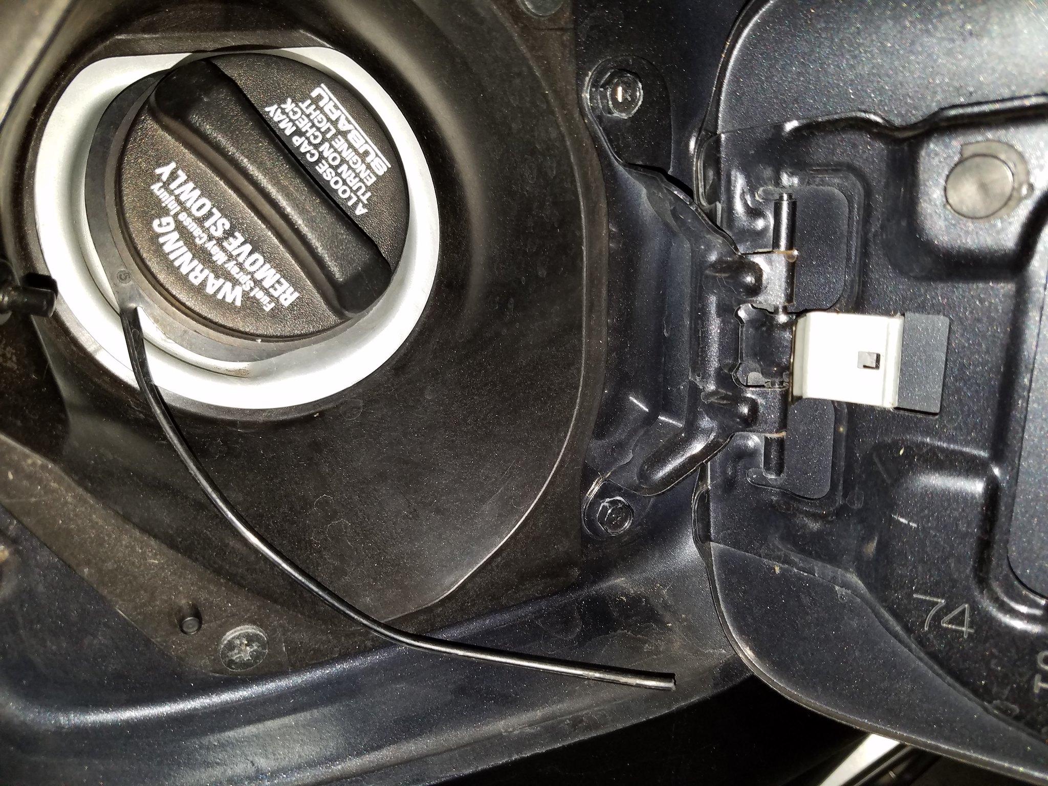 How to change the stock Subaru gas cap tether - NASIOC