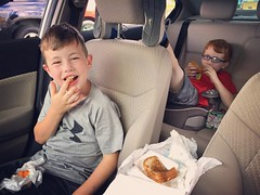 Happy boys. All three of us love to eat from a tray hanging off the car window!