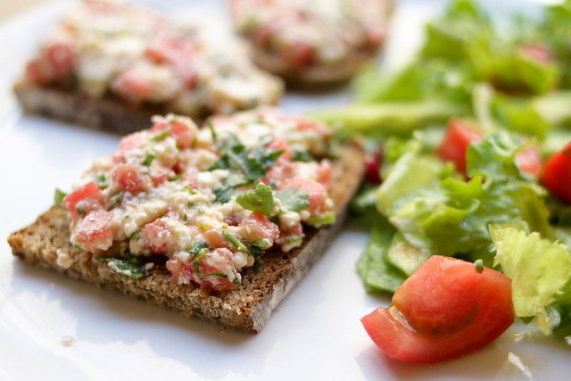 Fresh sandwich with tomatoes and green salad