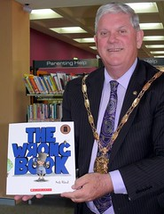 City of Cockburn Mayor, Logan Howlett holding a copy of The Wrong Book by Nick Bland