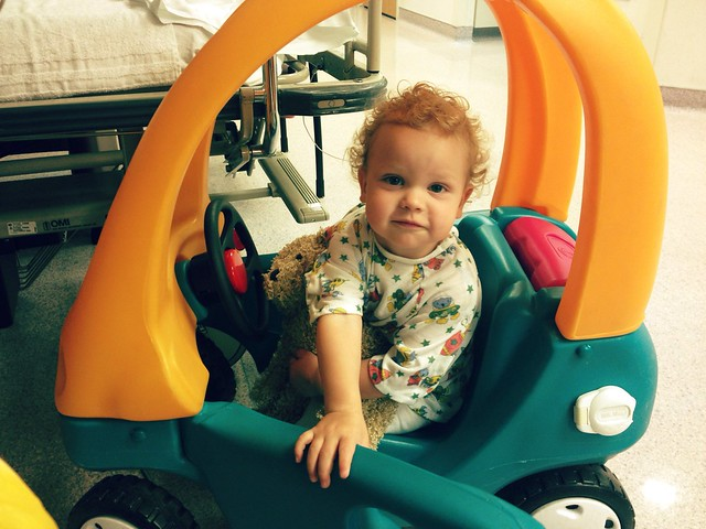 Lewis in his hospital gown and his hospital car