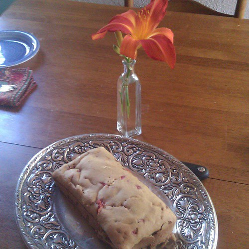 Lucas made strawberry bread sans recipe. He also set the table with matching cloth napkins and put a lily in a vase. I love this boy!