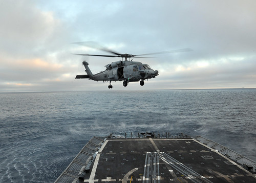 SH-60 Sea Hawk helicopter from Helicopter Sea Combat Squadron (HSC) 21 conducts touch-and-go maneuvers