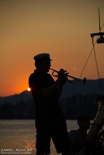 sunset portrait music sun lake playing beautiful sunrise canon landscape eos 50mm switzerland amazing artist suiza swiss awesome player f18 saxophone saxo montreux saxofon redsun orangesun 60d