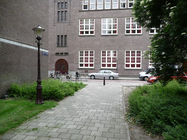 Amsterdam School architecture - facade and view over the small park between Plantage Westermanlaan and Middellaan; photo Amsterdam city; urban photographer Fons Heijnsbroek