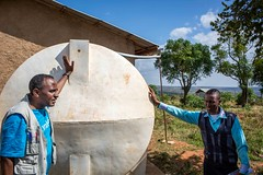Tamene Workneh, Unicef focal person for Oromia Regional Bureau of Education, left, and Dame Meskele, School Principal, show the water-catchment system at Tutis Primary School