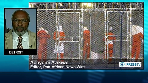 Abayomi Azikiwe, editor of the Pan-African News Wire, depicted in graphic for Press TV on Guantanamo Bay, January 30, 2014. Azikiwe is a frequent contributor to international media. by Pan-African News Wire File Photos