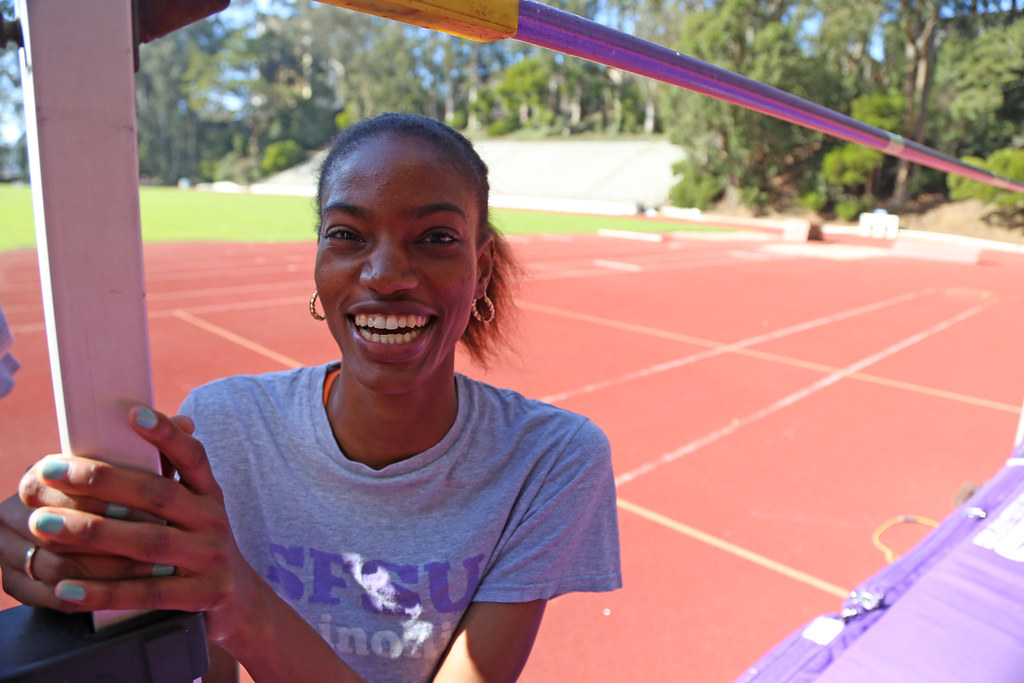 Tiana Wills, SF State senior and track athlete, poses at the track at SF State Tuesday, Feb. 25. Wills finished in second place in the high jump at the USATF Indoor Championships last Saturday with a new school record of 6-2. Photo by Rachel Aston / Xpress
