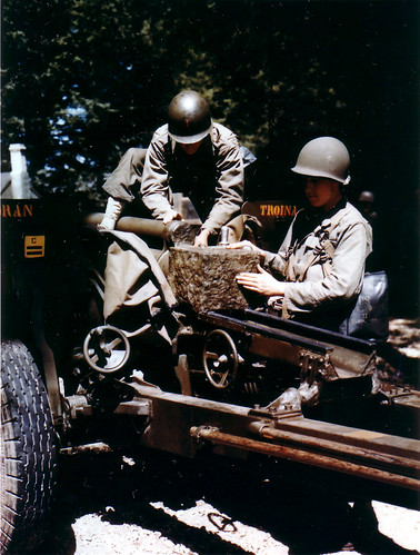USA Gunners prepare 76 mm anti-tank gun  (3 inch Gun M5) for transportation in preparation for Operation Overlord. June 1944.