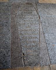 coffin-shaped ledger stone