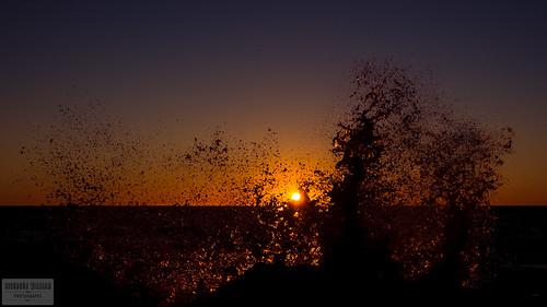 ocean sunset red sea sky sun wet water yellow rock stone dark frozen iceland rocky wave sunny shore freeze splash