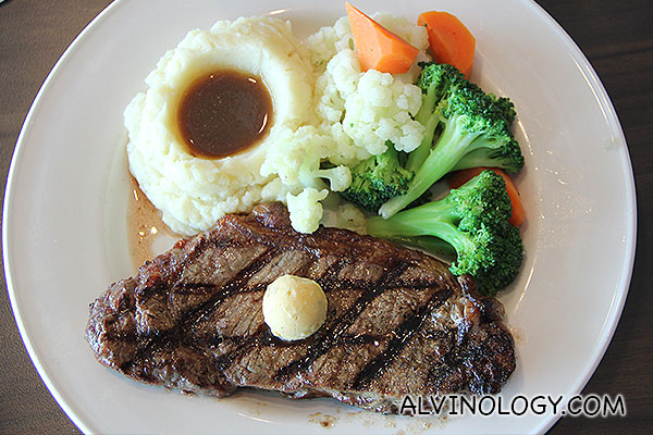 NEW YORK STRIP STEAK -  A (USDA) choice 21 day aged center-cut, 12 oz. New York strip steak grilled to your liking and topped with Merlot-garlic butter. Served with smashed potatoes, gravy and fresh vegetables.