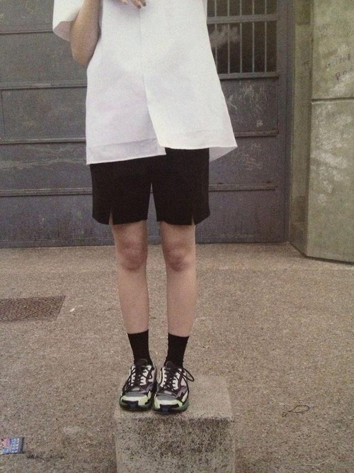 Raf Simons Runners with black socks and shorts, and white shirt editorial