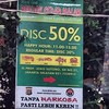 Curious billboard advert for seafood Resto. 50% discount! No drugs!