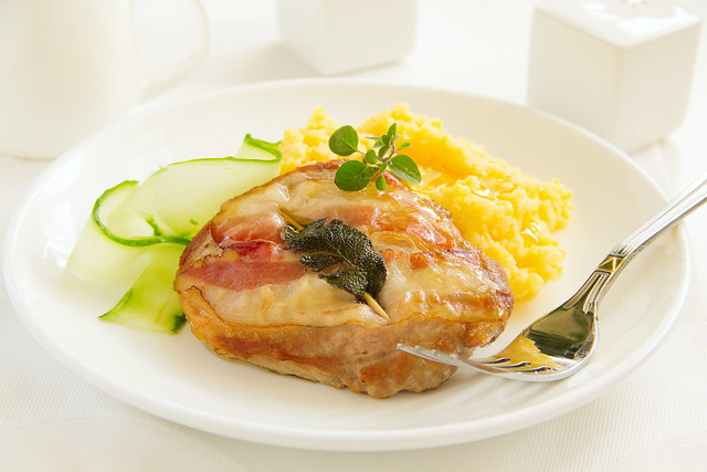 Saltimbocca with salad and polenta.