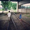 walking on the tracks. when xtian and anais were young