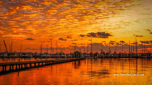 sun sunrise marina boats sailboats river stlucieriver sky clouds cloudy orange gold golden reflect reflects reflection nature mothernature seascape outdoors outside stuart florida