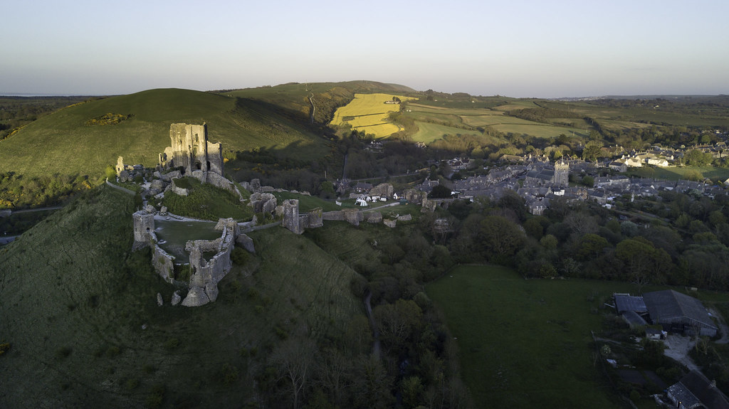 Sun setting over Corfe Castle, looking along the purbeck hills - Click to show full size