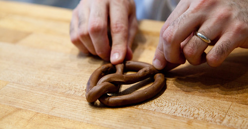 Shaping chocolate brioche into a pretzel