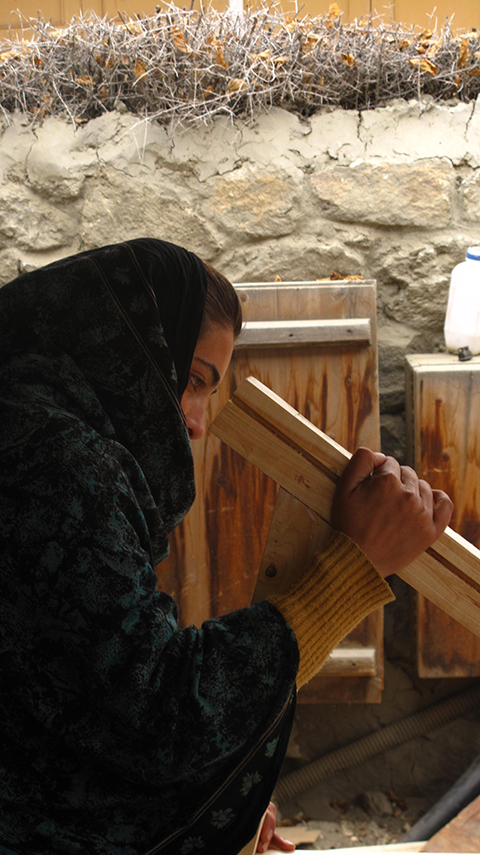 photo portrait of girl from the Karakoram Highway in Pakistan, taking a Aga Khan Foundation carpentry course