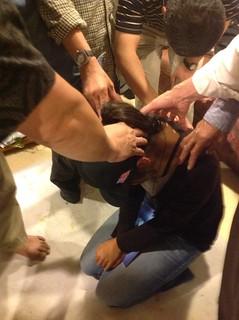 Các Mục Sư đặt tay cầu nguyện cho Haana lên đường nhập học--Laying hands on Haana, pastors were praying